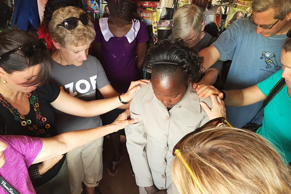 Hope Companions Praying with a Child