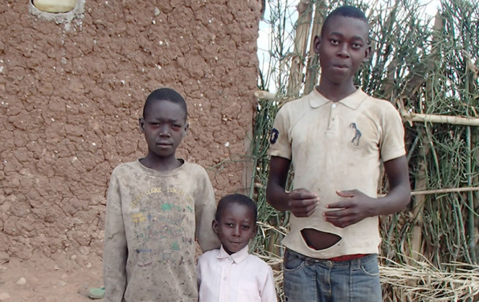 Samuel and his siblings in front of their house
