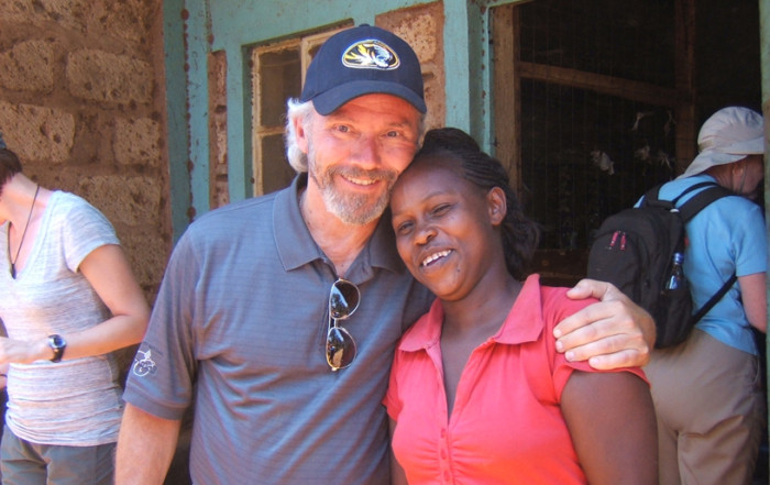 Mark McAndrew in Kenya with a ZOE participant